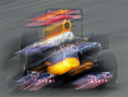 Red Bull driver Sebastian Vettel of Germany speeds into a turn during the first free practice session at the German Formula One Grand Prix at the Nuerburgring circuit, Germany, Friday, July 22, 2011. The German Grand Prix will be held Sunday, July 24, 2011. &#40;AP Photo&#47;Jens Meyer&#41; <span class=meta>(AP Photo&#47; Jens Meyer)</span>