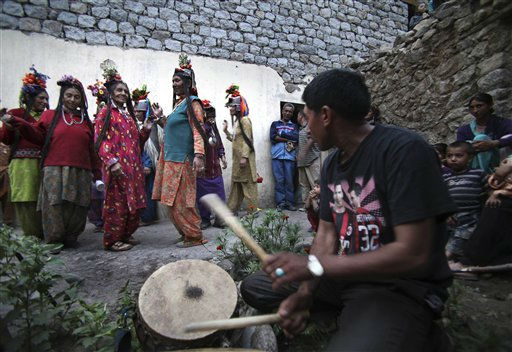 In this July 23, 2011 photo, Aryan Brogpa women, wearing traditional outfit, dance at Darchik, in Kargil district of Jammu and Kashmir state, India. The Brogpas, or Dards or Drokpas as they are also known, claim to be pure-blooded Aryans and have been subjects of study and debate of historians and researchers. Brogpas, numbering over a 1000, reportedly practice polygamy and polyandry and are prohibited from marrying outside their community to preserve their racial purity. &#40;AP Photo&#47;Channi Anand&#41; <span class=meta>(AP Photo&#47; Channi Anand)</span>