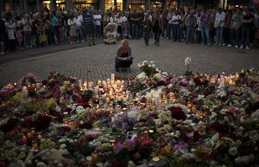 People gather during a candle light vigil to pay tribute to victims of the twin attacks near the Domkirke church on Friday, in central Oslo, Norway, Saturday, July 23, 2011. A massive bombing Friday in the heart of Oslo was followed by a horrific shooting spree on an island hosting a youth retreat for the prime minister&#39;s center-left party. The same man, a Norwegian with reported Christian fundamentalist, anti-Muslim views, was suspected in both attacks. &#40;AP Photo&#47;Emilio Morenatti&#41; <span class=meta>(AP Photo&#47; Emilio Morenatti)</span>