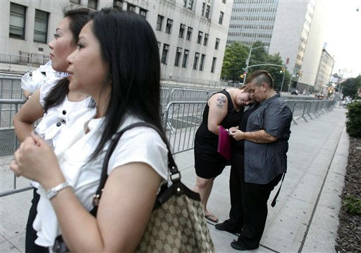 Heather Bruner, far right, and Jody Wicker, second right, both of Cleveland, embrace as they wait to get married at the Manhattan City Clerk&#39;s office, Sunday, July 24, 2011, in New York. &#40;AP Photo&#47;Jason DeCrow&#41; <span class=meta>(AP Photo&#47; Jason DeCrow)</span>