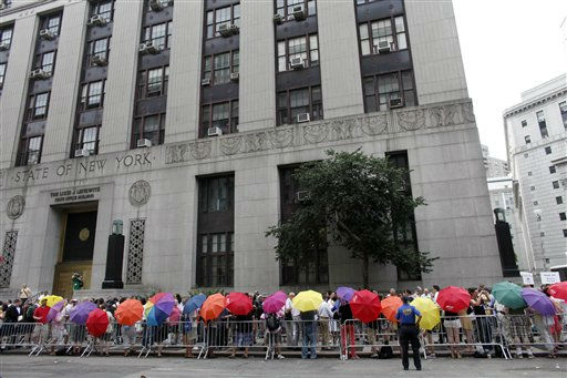 Same-sex couples wait in line to receive marriage licenses at the Manhattan City Clerk&#39;s office, Sunday, July 24, 2011, in New York. &#40;AP Photo&#47;Jason DeCrow&#41; <span class=meta>(AP Photo&#47; Jason DeCrow)</span>