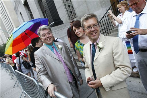 Richard Skipper, left, and Daniel Sherman, of Sparkill, N.Y., wait to get married at the Manhattan City Clerk&#39;s office, Sunday, July 24, 2011, in New York. &#40;AP Photo&#47;Jason DeCrow&#41; <span class=meta>(AP Photo&#47; Jason DeCrow)</span>