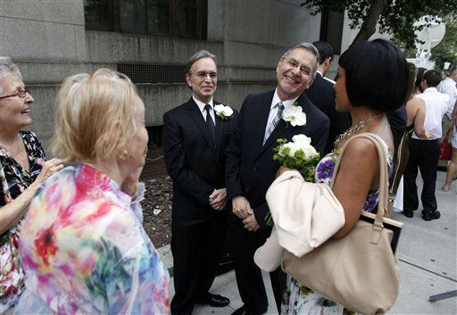 Joseph Oroza, left, and Jim Consolantis, both of New York, talk to their witness, Pam Hodges, as they wait to get married at the Manhattan City Clerk&#39;s office, Sunday, July 24, 2011, in New York. &#40;AP Photo&#47;Jason DeCrow&#41; <span class=meta>(AP Photo&#47; Jason DeCrow)</span>