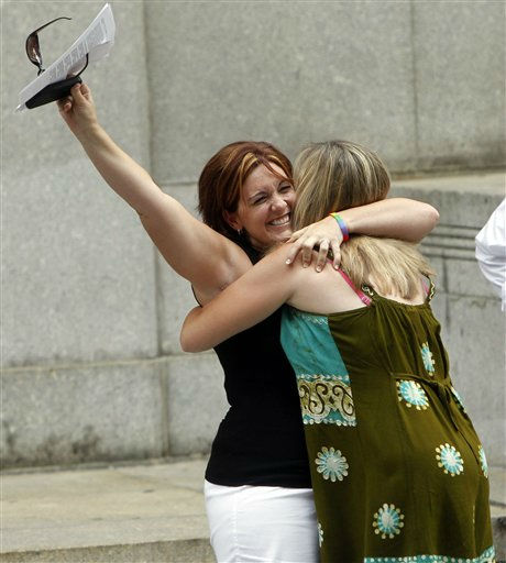 Wendy Torrington, left, and Kimberly Moreno, both of Long Beach, Miss., celebrate after getting their marriage license at the Manhattan City Clerk&#39;s office, Sunday, July 24, 2011 in New York. Sunday is the first day that same-sex couples can legally marry in New York. &#40;AP Photo&#47;Jason DeCrow&#41; <span class=meta>(AP Photo&#47; Jason DeCrow)</span>