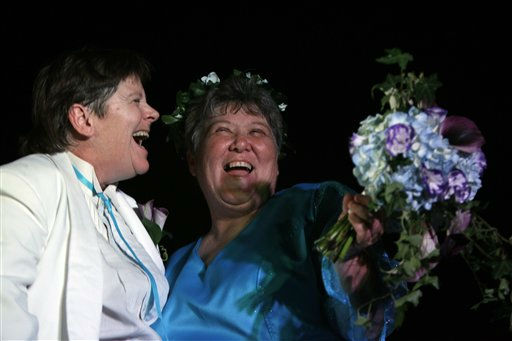 Kitty Lambert, left, dances with Cheryle Rudd after a spiritual ceremony before being married in Niagara Falls, N.Y., Saturday, July 23, 2011. &#40;AP Photo&#47;David Duprey&#41; <span class=meta>(AP Photo&#47; David Duprey)</span>