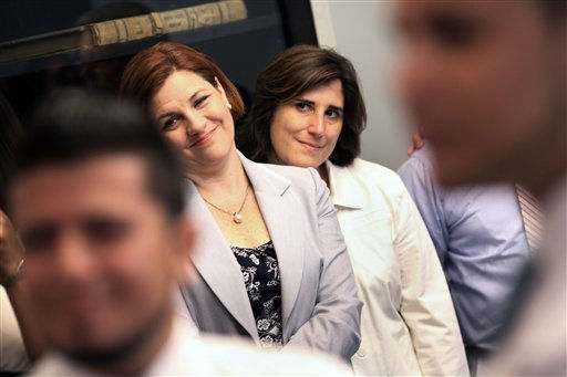 New York City Council Speaker Christine, left, and her partner Kim Catullo, attend the wedding of Marcos A. Chaljub and Freddy L. Sambrano at the Manhattan City Clerk&#39;s office on the first day New York State&#39;s Marriage Equality Act goes into effect, on Sunday, July 24, 2011. &#40;AP Photo&#47;Michael Appleton, Pool&#41; <span class=meta>(AP Photo&#47; Michael Appleton)</span>