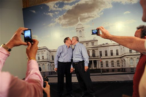 "<div class=""meta ""><span class=""caption-text "">Same-sex couple Ray Durand, left, and his partner Dale Shields kiss while having their picture taken after their wedding ceremony at the City Clerk's Office for their wedding ceremony in New York, Sunday, July 24, 2011.  (AP Photo/David Handschuh, Pool) (AP Photo/ David Handschuh)</span></div>"
