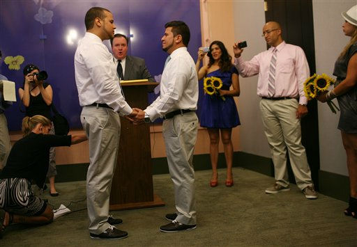 Marcos A. Chaljub, left, and Freddy L. Sambrano exchange vows at the Manhattan City Clerk&#39;s office  on the first day New York State&#39;s Marriage Equality Act goes into effect, on Sunday, July 24, 2011, in New York.   &#40;AP Photo&#47;Michael Appleton, Pool&#41; <span class=meta>(AP Photo&#47; Michael Appleton)</span>