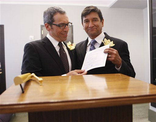 Same-sex couple Daniel Hernandez, 53, right, and Nevin Cohen, 48, hold their wedding certificate after  being married at the City Clerk&#39;s Office in New York, Sunday, July 24, 2011. A state law signed June 24 by Democratic Gov. Andrew Cuomo went into effect at 12:01 on Sunday, allowing hundreds of couples statewide to tie the knot, including 823 in New York City alone. &#40;AP Photo&#47;Shannon Stapleton, Pool&#41; <span class=meta>(AP Photo&#47; Shannon Stapleton)</span>