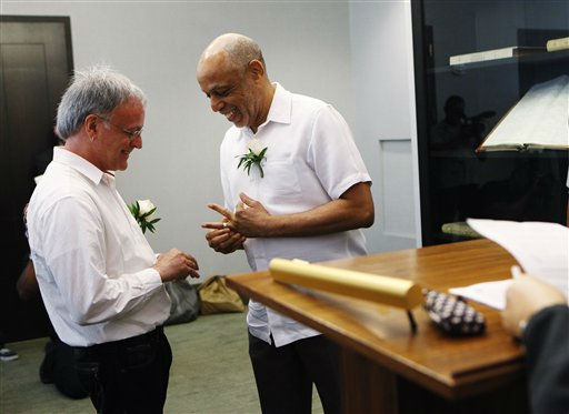 Same-sex couple Douglas Robinson, right, and Michael Elsasser exchange wedding rings during their wedding ceremony at the City Clerk&#39;s Office in New York, Sunday, July 24, 2011. Sunday is the first day that same-sex couples can legally marry in New York. &#40;AP Photo&#47;Shannon Stapleton, Pool&#41; <span class=meta>(AP Photo&#47; Shannon Stapleton)</span>