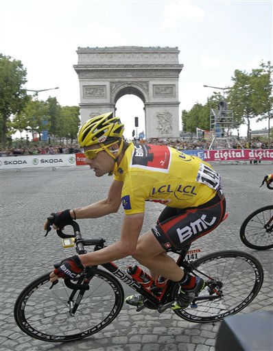Cadel Evans of Australia, wearing the overall leader&#39;s yellow jersey, cycles past the Arc de Triomphe during the 21st stage of the Tour de France cycling race over 95 kilometers &#40;59 miles&#41; starting in Creteil and finishing in Paris, France, Sunday July 24, 2011. &#40;AP Photo&#47;Laurent Cipriani&#41; <span class=meta>(AP Photo&#47; Laurent Cipriani)</span>