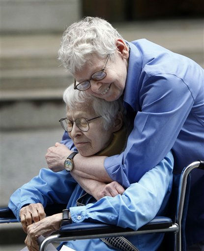 "<div class=""meta ""><span class=""caption-text "">Phyllis Siegel, 77, right, and Connie Kopelov, 85, both of New York, embrace after becoming the first same-sex couple to get married at the Manhattan City Clerk's office, Sunday, July 24, 2011, in New York. (AP Photo/Jason DeCrow) (AP Photo/ Jason DeCrow)</span></div>"