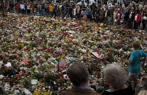 People pay tribute to victims of the twin attacks in central Oslo, Norway, Monday, July 25, 2011. The man who confessed to the twin attacks that killed 93 people in Norway will be arraigned in court Monday and has requested an open hearing for his first appearance so that he can explain his massacre to the public.  &#40;AP Photo&#47;Emilio Morenatti&#41; <span class=meta>(AP Photo&#47; Emilio Morenatti)</span>
