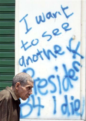 "<div class=""meta ""><span class=""caption-text "">An Egyptian walks under a slogan read  ""I want to see another president before I die"", in Cairo, Egypt, Monday, July 25, 2011. An Egyptian court decided Monday to combine the trials of the country's former interior minister and ousted President Hosni Mubarak for the killing of nearly 900 protesters during the 18-day uprising that toppled the longtime leader in February. The Cairo court's ruling set Aug. 3 as the start date for the trial of Mubarak and former interior minister Habib el-Adly.  (AP Photo/Amr Nabil) (AP Photo/ Amr Nabil)</span></div>"