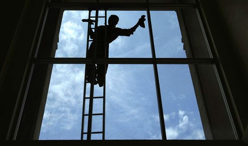 A Thai worker cleans a glass window of a building in Bangkok,Thailand, Monday July 25. 2011 &#40;AP Photo&#47;Sakchai Lalit&#41; <span class=meta>(AP Photo&#47; Sakchai Lalit)</span>