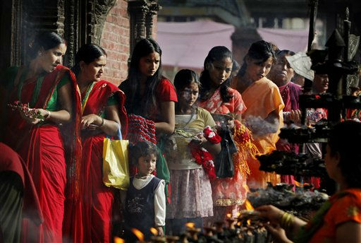 Nepalese Hindu women line up in queue to offer prayers at Gokarna Shiva temple on the outskirts of Kathmandu, Nepal, Monday, July 25, 2011. Hindus make up the majority of the population in Nepal, which was officially a Hindu nation until 2006.&#40;AP Photo&#47;Binod Joshi&#41; <span class=meta>(AP Photo&#47; Binod Joshi)</span>