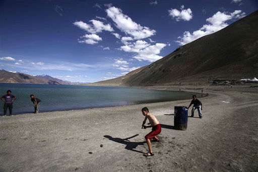 In this Friday, July 22, 2011 photo, children play cricket near Pangong Lake, near the India-China border in Ladakh, India. Ladakh is a remote part of the former princely state of Kashmir, which is at the heart of the six-decade conflict between nuclear-armed neighbors India and Pakistan. While Kashmir is best known for the Indo-Pakistani standoff, part of Ladakh, an ethnically distinct region with historical ties to Tibet, has been controlled by China for decades. &#40;AP Photo&#47;Channi Anand&#41; <span class=meta>(AP Photo&#47; Channi Anand)</span>