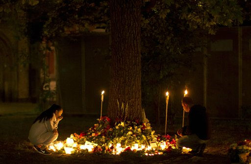 "<div class=""meta ""><span class=""caption-text "">Candles burn as people look at tributes outside the Oslo Cathedral in Oslo, in memory of the victims of Friday's bomb attack and shooting rampage, in the early hours of Tuesday, July 26, 2011.  The self-described perpetrator of Norway's deadly bombing and shooting rampage was ordered held in solitary confinement Monday after calmly telling a court that two other cells of collaborators stood ready to join his murderous campaign.  (AP Photo/Matt Dunham) (AP Photo/ Matt Dunham)</span></div>"