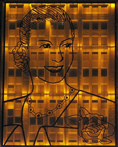 A 15 tons, 31x24 mt. iron portrait of the late  Evita Peron, the iconic wife of former Argentina&#39;s strongman Juan Peron, is illuminated by orange lights during an unveiling ceremony in the 59th anniversary of her death in Buenos Aires, Argentina, Tuesday, July 26, 2011. The portrait, placed on the facade of the Ministry of Social Development in central Buenos Aires, was unveiled by Argentina&#39;s President Cristina Fernandez.  &#40;AP Photo&#47;Eduardo Di Baia&#41; <span class=meta>(AP Photo&#47; Eduardo Di Baia)</span>