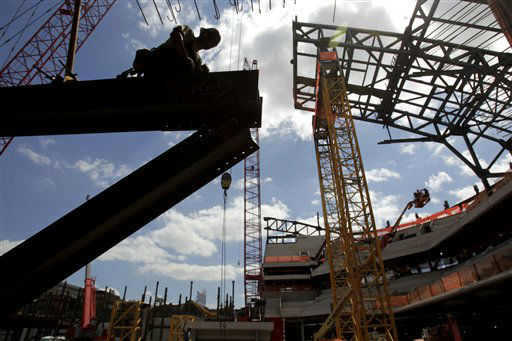 Construction continues on the Barclays Center in the Brooklyn section of New York, on Wednesday, July 27, 2011. The New Jersey Nets are full speed ahead with their plans to move, preparing to have the new arena finished in time to host their first game of the 2012-13 season. &#40;AP Photo&#47;Seth Wenig&#41; <span class=meta>(AP Photo&#47; Seth Wenig)</span>