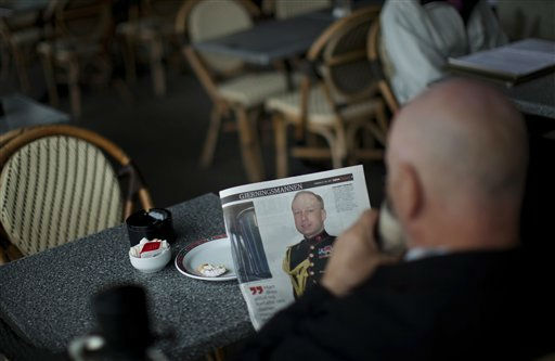 A man drinks coffee as he reads a newspaper with a prominent photo of Norway&#39;s twin terror attacks suspect Anders Behring Breivik in central Oslo, Norway, Wednesday, July 27, 2011. Norwegian government ministers begin returning to their bomb-damaged offices as the country slowly returns to a state of normalcy following a bombing and youth camp massacre that killed 68 people. &#40;AP Photo&#47;Emilio Morenatti&#41; <span class=meta>(AP Photo&#47; Emilio Morenatti)</span>