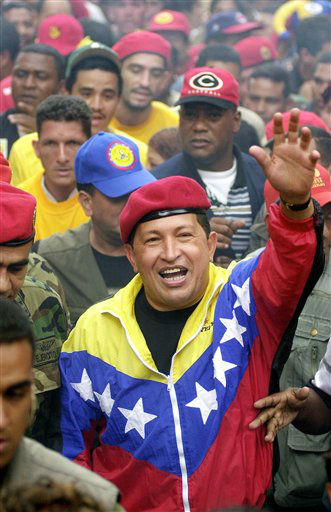 FILE - In this Jan. 23, 2002 file photo, Venezuela&#39;s President Hugo Chavez waves to supporters during a government march commemorating the anniversary of Venezuelan democracy in Caracas, Venezuela. Venezuela&#39;s Vice President Nicolas Maduro announced on Tuesday, March 5, 2013 that Chavez has died.  Chavez, 58, was first diagnosed with cancer in June 2011.  &#40;AP Photo&#47;Fernando Llano, File&#41; <span class=meta>(AP Photo&#47; Fernando Llano)</span>