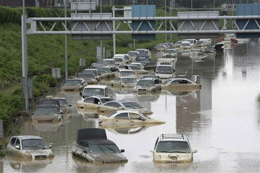 Vehicles are submerged in floodwater after heavy rain in Seoul, South Korea, Thursday, July 28, 2011. Thousands of rescuers used heavy machinery and shovels Thursday to clear mud and search for survivors after huge landslides and flooding killed more than 40 people in South Korea.&#40;AP Photo&#47;Ahn Young-joon&#41; <span class=meta>(AP Photo&#47; Ahn Young-joon)</span>