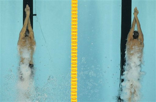 "<div class=""meta ""><span class=""caption-text "">Ryan Lochte, right, of the U.S. competes with his compatriot Michael Phelps to win the men's 200m Individual Medley final with a new world record of 1 minutes 54.00 seconds at the FINA Swimming World Championships in Shanghai, China, Thursday, July 28, 2011. Phelps finished second. (AP Photo/Gero Breloer) (AP Photo/ Gero Breloer)</span></div>"