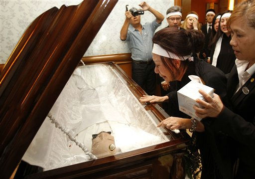 Le HoangKim Nicole, second from right, wife of South Vietnamese ex-leader Nguyen Cao Ky, cries while paying her last respects to her late husband during a funeral in Kuala Lumpur, Malaysia, Friday, July 29, 2011. Ky&#39;s family paid tribute to him at the tearful funeral Friday, urging people to remember him as a man who loved his homeland profoundly. &#40;AP Photo&#47;Lai Seng Sin&#41; <span class=meta>(AP Photo&#47; Lai Seng Sin)</span>