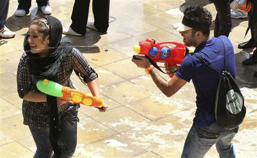 In this picture taken on Friday, July 29, Iranian youths shoot water to each other with their water guns, during water fights at the Water and Fire Park in northern Tehran, Iran. Iran is trying to put down a new wave of civil disobedience - flash mobs of young people who break into boisterous fights with water guns in public parks. A group of water fighters was arrested over the weekend, and a top judiciary official warned Monday that &#34;counter-revolutionaries&#34; were behind them. Throughout the summer, Iranian police have been cracking down. In the first incident, in July, hundreds of young men and women held a water fight in Tehran&#39;s popular Water and Fire Park, spraying each other with water guns and splattering bottles of water on one another. Police detained dozens of those involved.&#40;AP Photo&#47;Milad Beheshti&#41; <span class=meta>(AP Photo&#47; Milad Beheshti)</span>