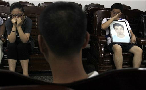 Family members of a victim of the high speed train crash weep at funeral parlor in Wenzhou, southeastern China&#39;s Zhejiang province, Friday, July 29, 2011.  Chinese Premier Wen Jiabao vowed Thursday to punish any corrupt person found responsible for a high-speed train crash that killed at least 39 people and triggered public anger over its handling. &#40;AP Photo&#47;Ng Han Guan&#41; <span class=meta>(AP Photo&#47; Ng Han Guan)</span>