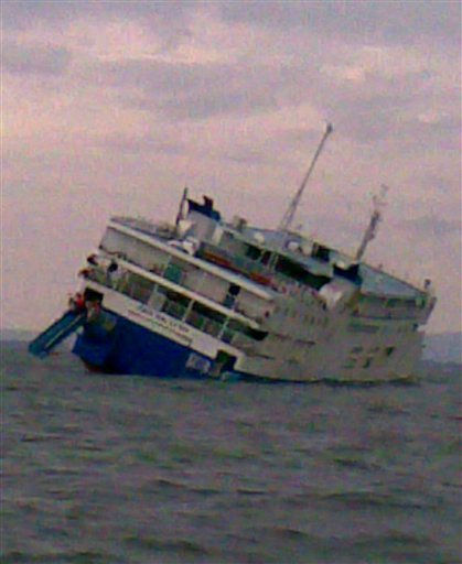 In this photo released by the Philippine coast guard, the steel-hulled M&#47;V Asia Malaysia tilts to its right, or starboard side, hours before it sank near Iloilo province, central Philippines, early Sunday, July 31, 2011. The coast guard and fishermen rescued about 170 people who were on board the 2,400-ton passenger ship. The cause of the problem was not immediately clear. &#40;AP Photo&#47;Philippine Coast Guard&#41; NO SALES <span class=meta>(AP Photo&#47; Anonymous)</span>