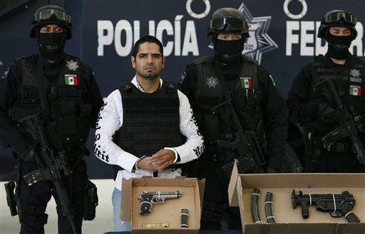 Jose Antonio Acosta Hernandez, 33, is presented to the media by federal police officers in Mexico City, Sunday July 31, 2011. According to federal officials, Acosta, nicknamed &#34;El Diego,&#34; is a key drug cartel figure, who acknowledged ordering 1,500 killings. He is also a suspect in last year&#39;s slaying of a U.S. consulate employee near a border crossing in Ciudad Juarez. Authorities identified Acosta as head of La Linea, a gang of hit men and corrupt police officers who act as enforcers for the Juarez Cartel. &#40;AP Photo&#47;Marco Ugarte&#41; <span class=meta>(AP Photo&#47; Marco Ugarte)</span>