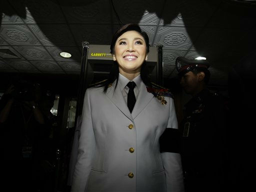Thai prime minister-to-be Yingluck Shinawatra arrives at Parliament in Bangkok, Thailand, Monday, Aug. 1, 2011. Recently elected Thai lawmakers gathered for the official opening of parliament Monday. &#40;AP Photo&#47;Sakchai Lalit&#41; <span class=meta>(AP Photo&#47; Sakchai Lalit)</span>