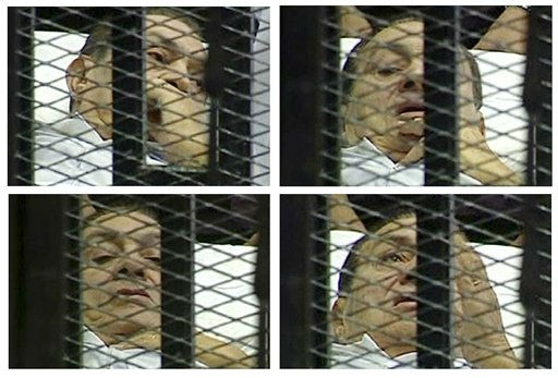 This combination image made from video taken from Egyptian State Television shows different scenes of 83-year-old Hosni Mubarak on a hospital bed inside a cage of mesh and iron bars in a Cairo courtroom Wednesday, Aug. 3, 2011 as his historic trial began on charges of corruption and ordering the killing of protesters during the uprising that ousted him. The scene, shown live on Egypt&#39;s state TV, was Egyptians&#39; first look at their former president since Feb. 10, the day before his fall when he gave a defiant speech refusing to resign.   &#40;AP Photo&#47;Egyptian State TV&#41;   EGYPT OUT <span class=meta>(AP Photo&#47; Anonymous)</span>