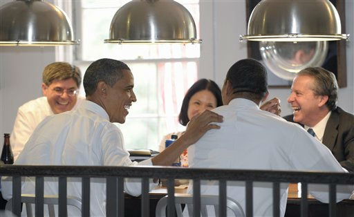 President Barack Obama shares a laugh with Assistant to the President and Director of Legislative Affairs Rob Nabors, second from right, as they eat lunch at Good Stuff Eatery in Washington, Wednesday, Aug. 3, 2011. From left are, Budget Director Jacob Lew, the president, Deputy Chief of Staff Nancy DeParle, and Nabors, and National Economic Council Director Gene Sperling. &#40;AP Photo&#47;Susan Walsh&#41; <span class=meta>(AP Photo&#47; Susan Walsh)</span>