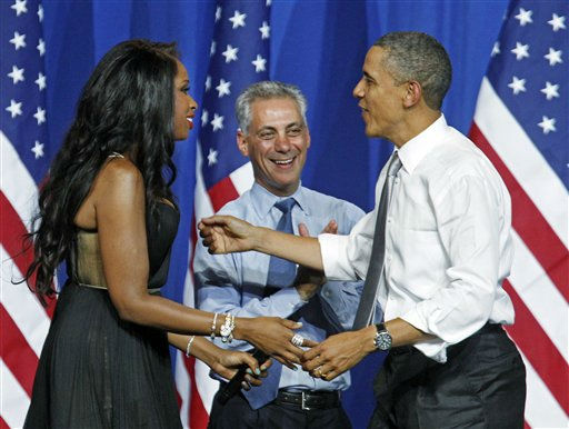 President Barack Obama is welcomed by singer Jennifer Hudson, and Chicago Mayor, Rahm Emanuel at a fundraiser on the eve of his 50th birthday, Wednesday, Aug. 3, 2011, in Chicago. &#40;AP Photo&#47;M. Spencer Green&#41; <span class=meta>(AP Photo&#47; M. Spencer Green)</span>
