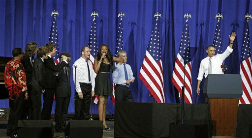 Entertainer Jennifer Hudson leads the Chicago Mayor Rahm Emanuel, other entertainers and the audience in singing Happy Birthday to President Barack Obama at a fundraiser on the eve of his 50th birthday, Wednesday, Aug. 3, 2011, in Chicago. &#40;AP Photo&#47;M. Spencer Green&#41; <span class=meta>(AP Photo&#47; M. Spencer Green)</span>