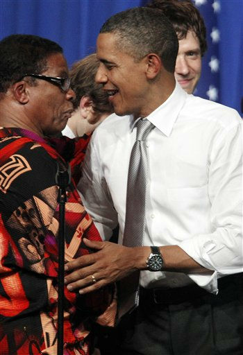 President Barack Obama is greeted by musician Herbie Hancock at a fundraiser on the eve of Obama&#39;s 50th birthday, Wednesday, Aug. 3, 2011, in Chicago. &#40;AP Photo&#47;M. Spencer Green&#41; <span class=meta>(AP Photo&#47; M. Spencer Green)</span>