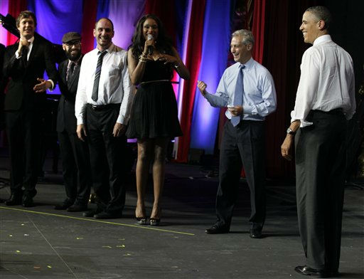 President Barack Obama is greeted by musician Jennifer Hudson, third from right, and members of the band OK Go and Chicago Mayor Rahm Emanuel, second from right, before speaking at the Aragon Ballroom, Wednesday, Aug. 3, 2011, in Chicago, at a fundraiser on the eve of his 50th birthday. &#40;AP Photo&#47;Carolyn Kaster&#41; <span class=meta>(AP Photo&#47; Carolyn Kaster)</span>