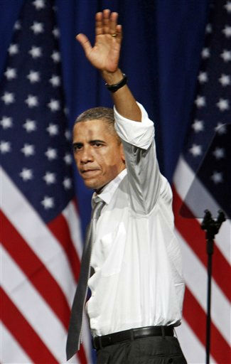 "<div class=""meta ""><span class=""caption-text "">President Barack Obama waves to the crowd after speaking at a fund raiser on the eve of his 50th birthday, Wednesday, Aug. 3, 2011, in Chicago. (AP Photo/M. Spencer Green) (AP Photo/ M. Spencer Green)</span></div>"