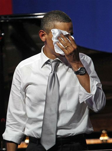 President Barack Obama wipes the sweat from his face after speaks at a fundraiser on the eve of his 50th birthday, Wednesday, Aug. 3, 2011, in Chicago. &#40;AP Photo&#47;M. Spencer Green&#41; <span class=meta>(AP Photo&#47; M. Spencer Green)</span>