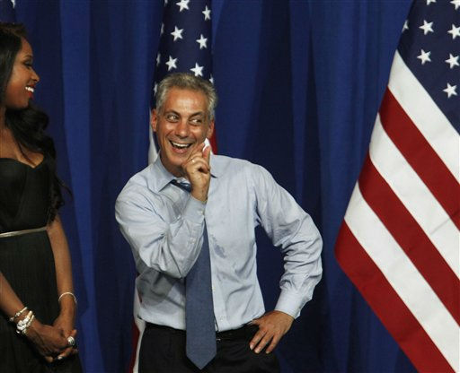 Chicago Mayor Rahm Emanuel shows President Barack Obama how close the mayor has come to swearing since taking office as Obama is welcomed by singer Jennifer Hudson, and  Emanuel at a fundraiser on the eve of his 50th birthday, Wednesday, Aug. 3, 2011, in Chicago. &#40;AP Photo&#47;M. Spencer Green&#41; <span class=meta>(AP Photo&#47; M. Spencer Green)</span>