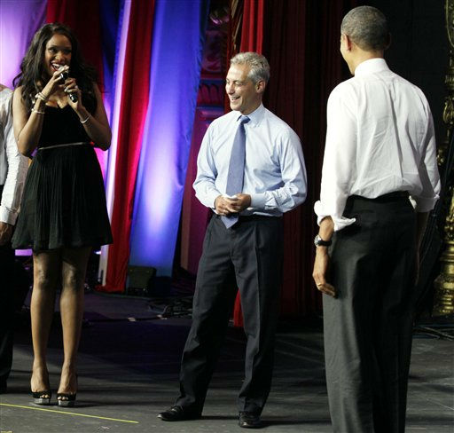 President Barack Obama, right, is greeted by musician Jennifer Hudson, left, and Chicago Mayor Rahm Emanuel before speaking at the Aragon Ballroom, Wednesday, Aug. 3, 2011, in Chicago,  at a fundraiser on the eve of his 50th birthday. &#40;AP Photo&#47;Carolyn Kaster&#41; <span class=meta>(AP Photo&#47; Carolyn Kaster)</span>