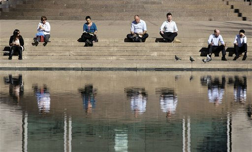People enjoy a warm Australian winter&#39;s day sitting near a pond in Sydney&#39;s Hyde Park, Thursday, Aug. 4, 2011. &#40;AP Photo&#47;Rick Rycroft&#41; <span class=meta>(AP Photo&#47; Rick Rycroft)</span>