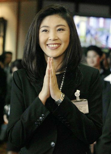 Thailand&#39;s new Prime Minister Yingluck Shinawatra gives a Thai traditional &#34;wai&#34; greeting at parliament in Bangkok Friday, Aug. 5, 2011. Thai lawmakers chose U.S.-educated businesswoman Yingluck as the country&#39;s first female prime minister on Friday. &#40;AP Photo&#47;Sakchai Lalit&#41; <span class=meta>(AP Photo&#47; Sakchai Lalit)</span>