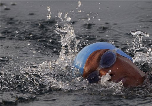 American endurance swimmer Diana Nyad , 61, swims in Cuban waters, offshore Havana, Cuba, Sunday, Aug. 7, 2011. Nyad jumped into Cuban waters Sunday evening and set off in a bid to become the first person to swim across the Florida Straits without the aid of a shark cage. &#40;AP Photo&#47;Franklin Reyes&#41; <span class=meta>(AP Photo&#47; Franklin Reyes)</span>