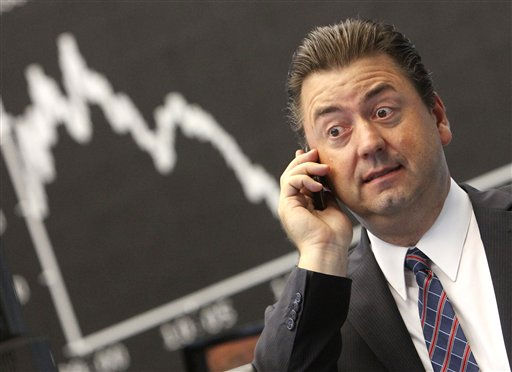 Robert Halver, chief analyst of a German private bank makes a phone call under the curve of the German stock index DAX at the stock market in Frankfurt, Germany, Monday, Aug. 8, 2011, where the stock index fell after the opening of the trading. &#40;AP Photo&#47;Michael Probst&#41; <span class=meta>(AP Photo&#47; Michael Probst)</span>