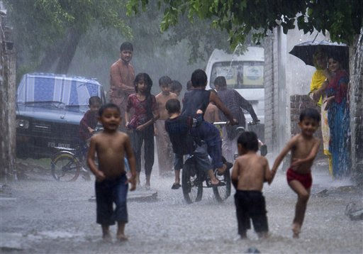 Pakistani children enjoy playing in a heavy downpour in Islamabad, Pakistan on Monday, Aug. 8, 2011. According to the Pakistani meteorological office Islamabad received 85 mm rainfall in couple of hours. &#40;AP Photo&#47;B.K.Bangash&#41; <span class=meta>(AP Photo&#47; B.K.Bangash)</span>
