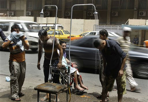 People take an open air shower in central Baghdad, Iraq, Monday Aug. 8, 2011. &#40;AP Photo &#47; Hadi Mizban&#41; <span class=meta>(AP Photo&#47; Hadi Mizban)</span>